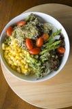 Mixed salad bowl on wood Stock Photos