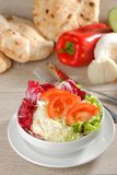 Mixed salad with a bread Stock Image