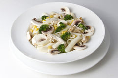 Mixed salad with eggs, pasta, mushrooms and chicken meat Stock Images