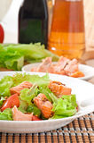Mixed salad of fresh vegetables with pieces of salmon Royalty Free Stock Image
