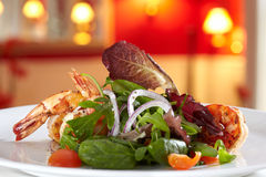 Mixed salad with fried scampis. Royalty Free Stock Images