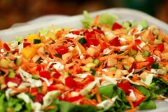 Mixed salad of fruits and vegetables and various flavors. Mixed salad of fruits and vegetables and various flavors: fresh tomatoes, cucumbers, cabbage, green royalty free stock photography