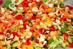 Mixed salad of fruits and vegetables and various flavors. Mixed salad of fruits and vegetables and various flavors: fresh tomatoes, cucumbers, cabbage, green royalty free stock photos