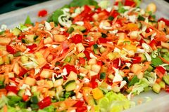 Mixed salad of fruits and vegetables and various flavors. Mixed salad of fruits and vegetables and various flavors: fresh tomatoes, cucumbers, cabbage, green royalty free stock photo