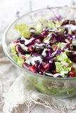 Mixed salad on glass bowl with red beans, seeds, purple cabbage and greek yogurt sauce Stock Image