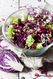 Mixed salad on glass bowl with red beans, seeds and purple cabbage Stock Images