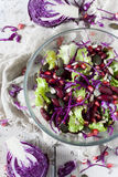 Mixed salad on glass bowl with red beans, seeds and purple cabbage Stock Photo