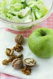 Mixed salad with green apple and walnuts stock photos