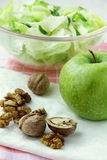Mixed salad with green apple and walnuts Royalty Free Stock Photo
