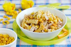 Mixed salad from ham, cheese, boiled egg, canned corn and bread crusts for Easter dinner. Mixed salad from ham, cheese, boiled egg, canned corn and bread crusts stock photo