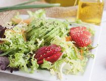 Mixed salad leaves with strawberries and avocado. Salad leaves with strawberries and avocado Royalty Free Stock Images