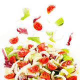 Mixed salad, lettuce, radicchio, fennel, pachino tomatoes. Mixed salad in glass dish and white background. Raw food Stock Photography