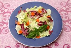 Mixed salad. A mixed salad of lettuce with carrots and herbs Royalty Free Stock Photos
