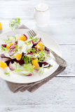 Mixed salad on a plate royalty free stock photography