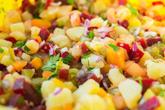 Mixed salad with potatoes, carrots, onions, beets and parsley Stock Photo