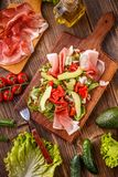 Mixed salad with prosciutto Stock Photo