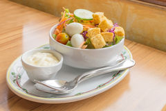 Mixed salad with salad cream. Dressing Stock Photo