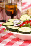 Mixed salad on a set table Royalty Free Stock Images