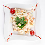 Mixed salad with smoked foods. Tomato, iceberg and cheese Royalty Free Stock Photography