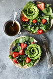 Mixed salad with spinach,berries and avocado rose with honey mustard dressing Royalty Free Stock Photo