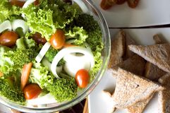 Mixed salad and wheat bread Royalty Free Stock Images