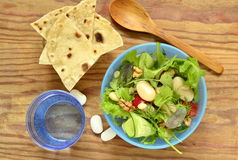 Mixed salad with white beans, greens, cucumbers and sweet peppers Stock Images