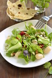 Mixed salad with white beans, greens, cucumbers and sweet peppers Stock Photos