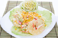 Mixed salad with white dressing served pretty on a large plate Royalty Free Stock Images