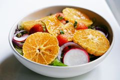 Mixed salad on white plate with preserved salmon consists of fresh vegetables such as hydroponics plants, beetroot, purple onion. And radish and add sour flavor Stock Images