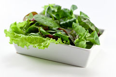 Mixed salad on white table Stock Images