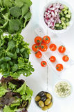 Mixed salad on white table Royalty Free Stock Images