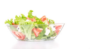 Mixed salat in a glass bowl isolated on white. Stock Image