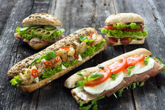Mixed sandwiches. On a wooden background Stock Photos