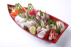 Mixed Sashimi set in red boat bowl isolated on white background. Royalty Free Stock Photography