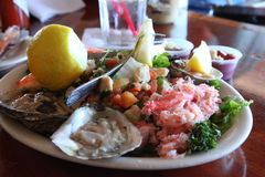 Mixed Seafood  lunch set. Mixed seafood set with oyster, crab ,salad and lemon Royalty Free Stock Photos