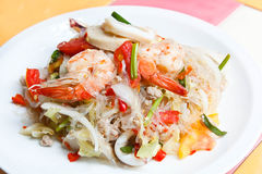 Mixed seafood and pork spicy Thai salad. Royalty Free Stock Image