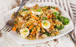 Mixed seafood salad with quinoa and quail eggs. Stock Photography