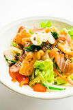 Mixed seafood salad with salmon tuna squid and other fish Stock Photos