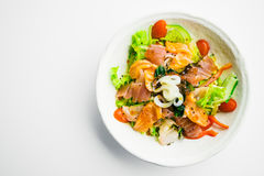 Mixed seafood salad with salmon tuna squid and other fish Stock Photography