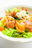 Mixed seafood salad with salmon tuna squid and other fish Royalty Free Stock Images