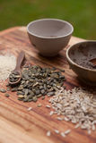 Mixed seeds on wooden background Royalty Free Stock Photography