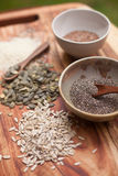 Mixed seeds on wooden background Stock Photography