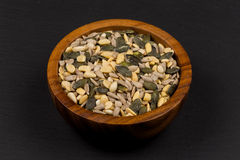 Mixed seeds in wooden bowl Royalty Free Stock Photos
