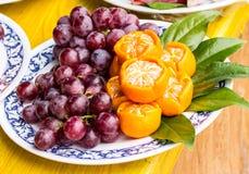 Mixed set of fresh raw ripe fruits. Orange and grape Royalty Free Stock Photo