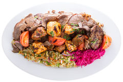 Mixed shish kebabs served with vegetables Stock Photos