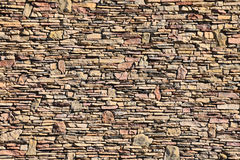 Mixed Size Stone Wall. A rich textured large area mixed sized dry stone wall royalty free stock images