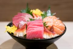Mixed sliced fish sashimi on ice in black bowl. Sashimi Salmon T Royalty Free Stock Image