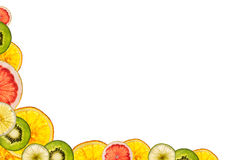 Mixed sliced fruits isolated on white background back lighted as Royalty Free Stock Photography