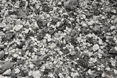 Mixed small gravels and asphalt Stock Images