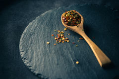 Mixed spice on spoon Royalty Free Stock Photo